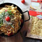 Fettuccine in Trüffelbutter mit Kirschtomaten, Ruccola und Granna Padano